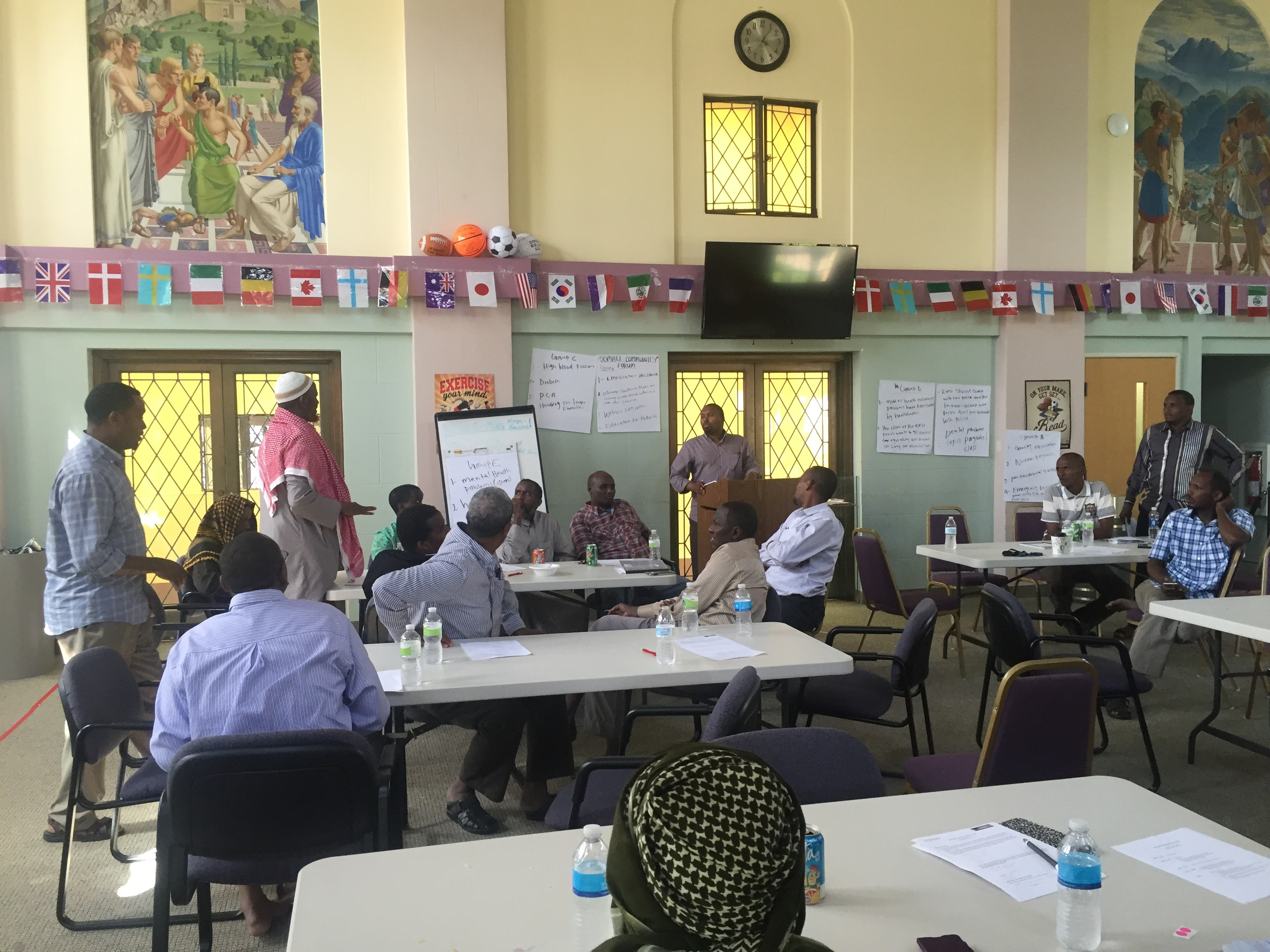 Photos from a community roundtable in July 2016.